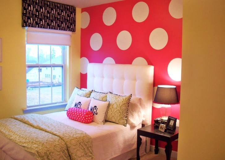 golden bedroom with red and white polka dot wall room decor and
