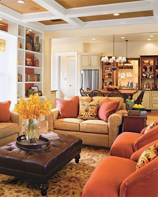 Warm Orange And Gold Open Living Room